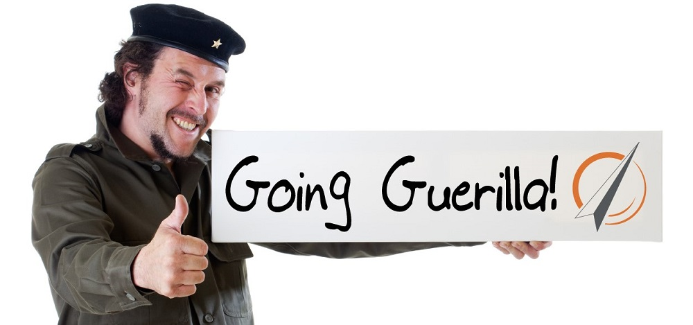 Guerilla soldier with thumbs up and sign that says Going Guerilla PROSAR.