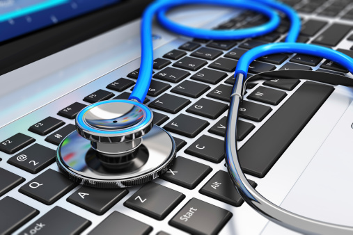 Stethoscope on laptop keyboard to diagnose seo